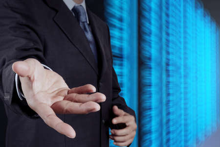 businessman hand open and server room background as concept