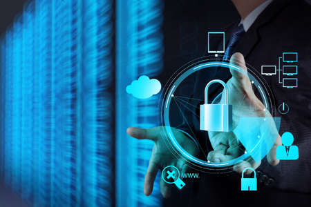 security: businessman hand showing 3d padlock on touch screen computer as Internet security online business concept