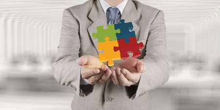 businessman Hand showing 3d puzzle as concept  photo