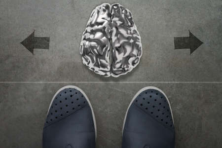 brain storm: 3d human metal brain on front of business man feet as concept  Stock Photo