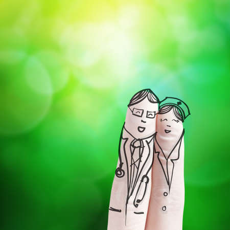 cartoon nurse: lovely couple hand drawn and finger,doctor and nurse with green nature background as concept