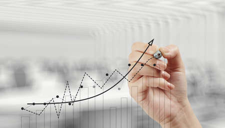 financial performance: hand drawing graph chart and business strategy as concept  Stock Photo