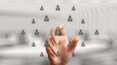 idioms: businessman hand points the human resources, CRM and social media diagram as concept