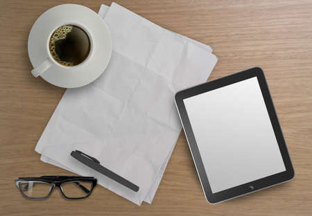 3d empty tablet and a cup of coffee on the wooden desk  photo