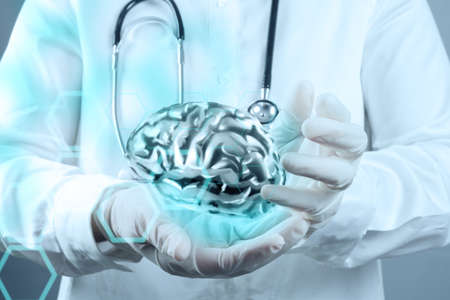 medical  doctor with brain3d meatl in his hands as concept photo