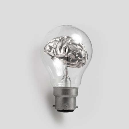 filaments: 3d metal human brain in a lightbulb as creative concep