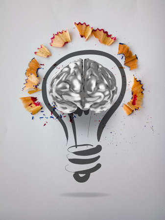 hand drawn light bulb with pencil saw dust and 3d brain icon on paper background as creative concept  photo