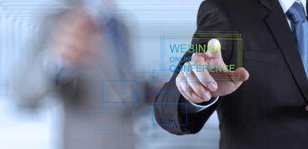 webinar: businessman hand show webinar online conference as concept