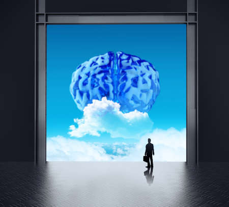 silhouette businessman looking to brain as cloud icon concept  photo