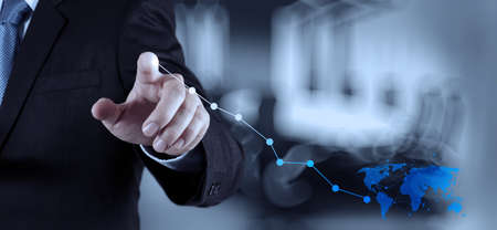 performance management: businessman hand working with new modern computer and business strategy as concept Stock Photo
