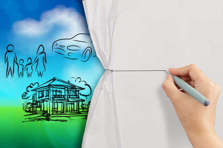 hand open crumpled paper to show planning family future blue and green nature background as concept Stock Photo