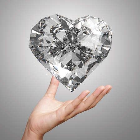 coeur diamant: main tenant 3d forme de coeur de diamant en tant que concept Banque d'images