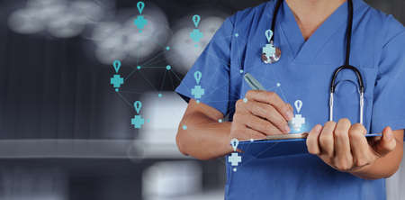 Medical Doctor working  with note board as medical network concept photo