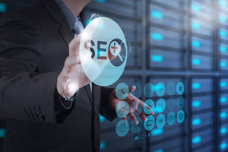 optimization: businessman hand showing search engine optimization SEO as concept