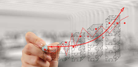 methods: businessman hand puzzle charts with new modern computer and business strategy as concept  Stock Photo