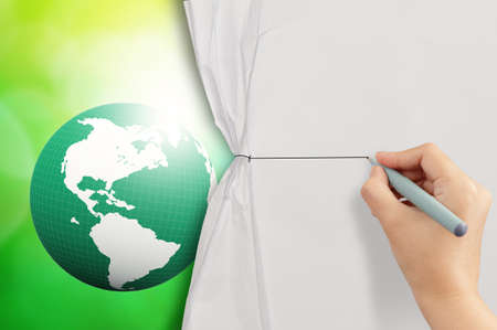 hand drawing rope to open crumpled paper to show 3d earth globe against blue and green nature   photo