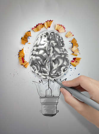 hand drawing light bulb with pencil saw dust and 3d brain icon on paper photo