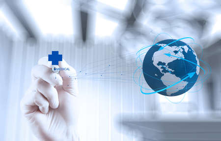 Medical Doctor hand  drawing the world globe in his hands as medical network concept  photo
