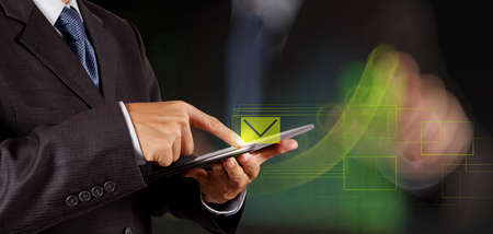 penfriend: businessman hand use interactive computer with virtual email icon as concept Stock Photo