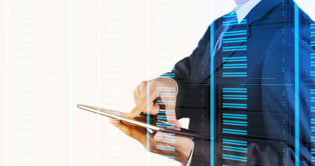 virtual server: Double exposure of businessman hand pressing a touchscreen button on server background