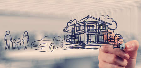 real estate planning: hand draws planning family future as concept  Stock Photo