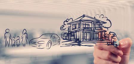 casa: mano disegna la pianificazione futura famiglia come concetto Archivio Fotografico