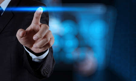 businessman hand pressing button with contact on virtual screens as concept photo