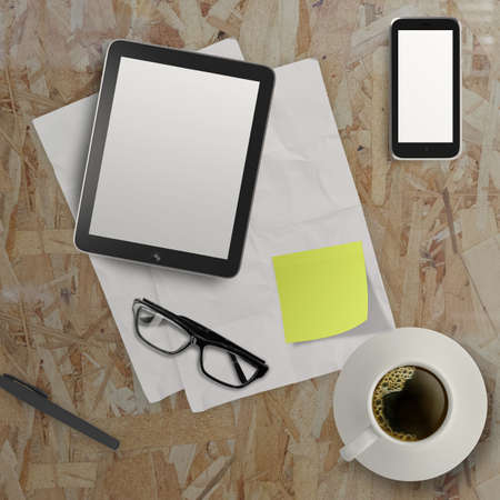 3d empty tablet and a cup of coffee with note pad on the wooden desk  photo