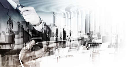 Double exposure of businessman and abstract city as concept photo