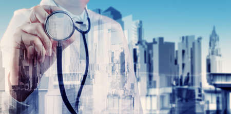 urgent care: Double exposure of smart medical doctor working with abstract city as concept  Stock Photo