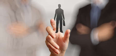 sticky hands: businessman hand choosing people icon as human resources concept