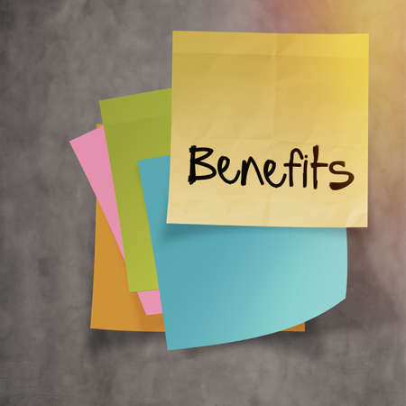 budgetary: benefits text on sticky note paper on wall texture Stock Photo