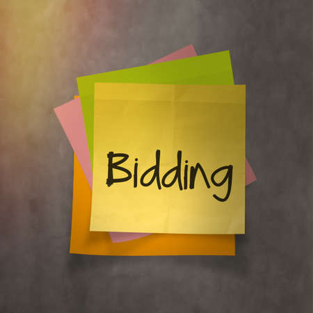bidding: bidding text on sticky note paper on wall texture