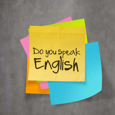 do you speak english text on sticky note paper on wall texture photo