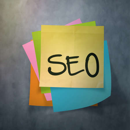 relevance: seo text on sticky note paper on wall texture Stock Photo