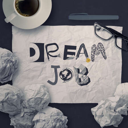 dream: hand drawn design words DREAM JOB on crumpled paper background as concept Stock Photo