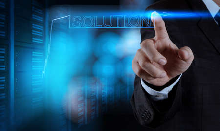 education help: businessman hand pushing solution graph on a touch screen interface Stock Photo