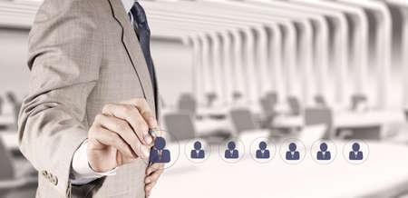 sticky hands: businessman hand choosing people icon as human resources concept Stock Photo