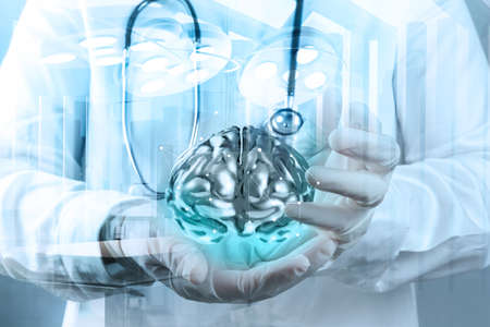 Double exposure of doctor neurologist hand show metal brain with computer interface as concept