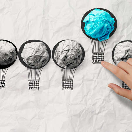 inspiration determination: hand drawn air balloons with crumpled paper ball as leadership concept Stock Photo