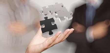 mision: mano de negocios que muestra el signo asociación rompecabezas 3d como concepto