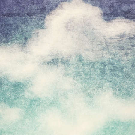 yellowed: Vintage background in the blue shade with clouds texture Stock Photo