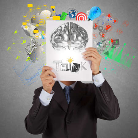 businessman hand show book of think word and 3d metal brain as concept photo