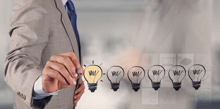 opportunity: hand drawing creative business strategy with light bulb as concept