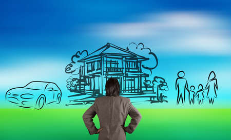 financial protection: businessman looking at  planning family future on blur nature background as concept