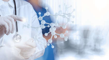 scientist doctor hand holds virtual molecular structure in the lab as concept photo