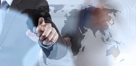 Double exposure of businessman hand working on world map on touch screen computer as concept photo