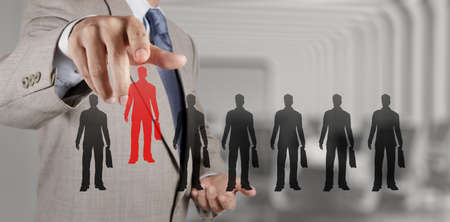 businessman hand choosing people icon as human resources concept photo