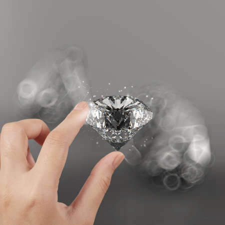 carat: hand holding 3d diamond over grey background Stock Photo