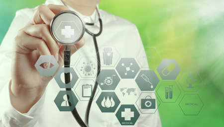 Double exposure of smart medical doctor holding a a stethoscope with nature background as concept